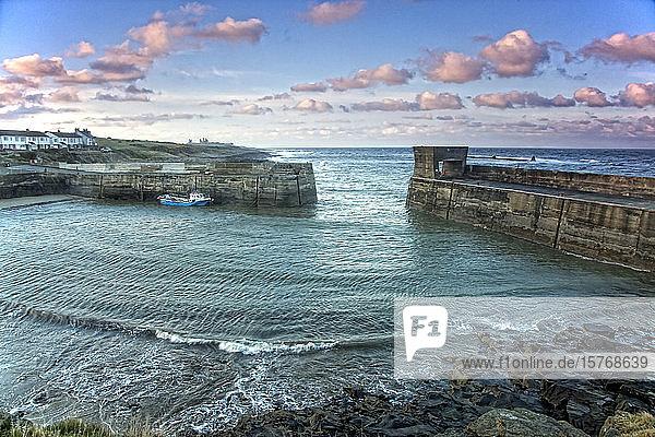 Idyllic seascape view beyond jetty Craster Northumberland UK