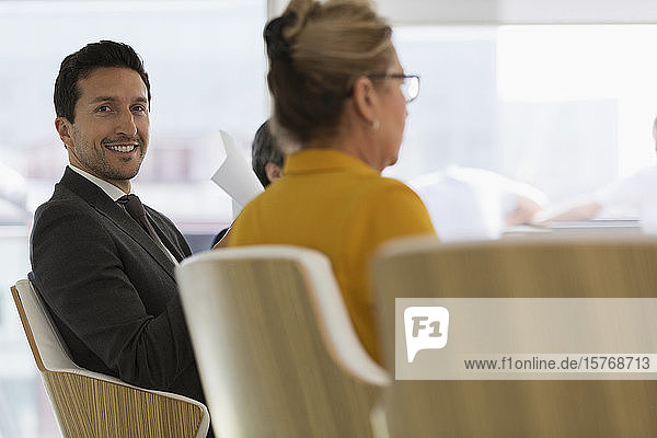 Portrait smiling  confident businessman in conference room meeting