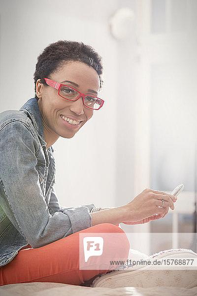 Portrait smiling  confident woman using smart phone