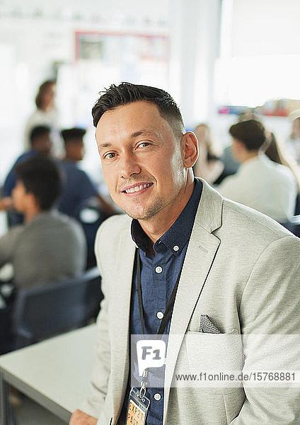 Portrait confident male high school teacher in classroom