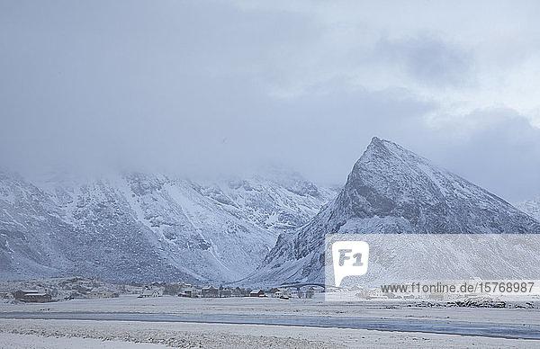 Majestic snow covered mountains above village Ramberg Lofoten Norway