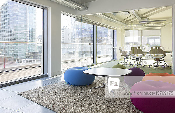Creative open plan office space with bean bag chairs