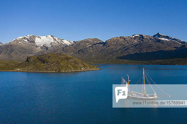 Ship in sunny remote bay Disko Bay West Greenland
