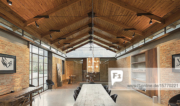 Home showcase interior with vaulted wood ceiling