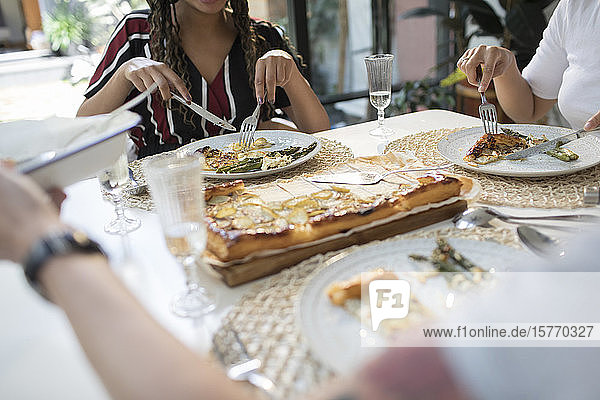 Women friends enjoying lunch at dining table