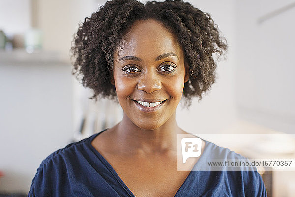 Portrait beautiful smiling woman with short black curly hair