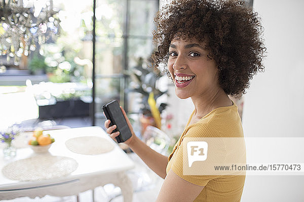 Portrait happy young woman using smart phone