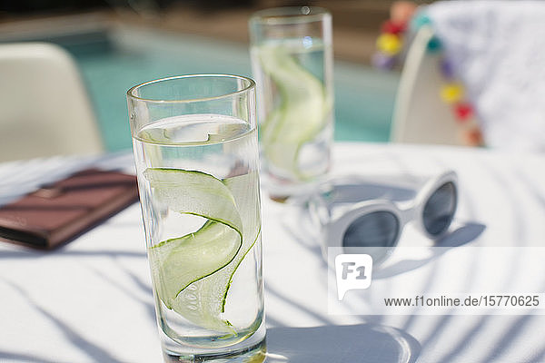 Close up cucumber water on sunny patio table