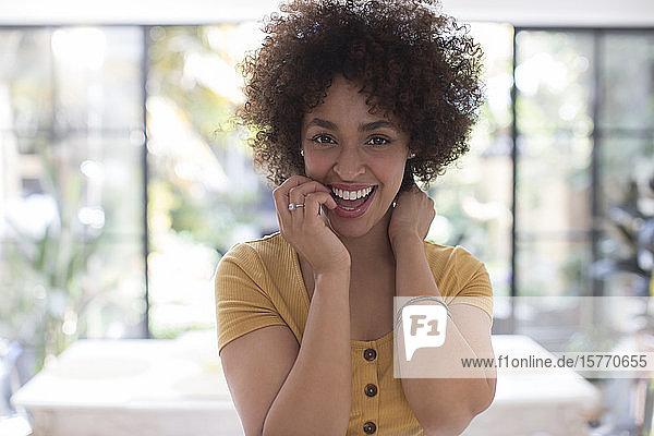 Portrait happy confident young woman