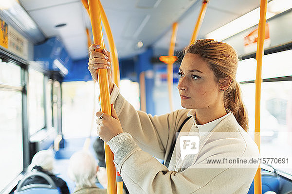 Young woman riding bus