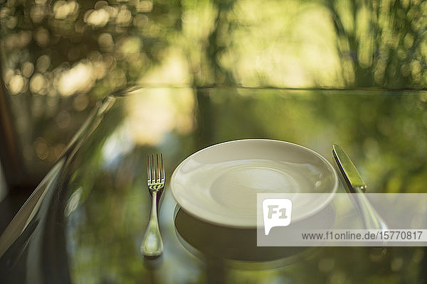 Placesetting on glass table