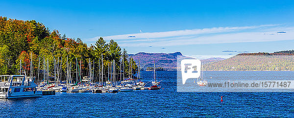 Boats mooring in a harbour in the city of Mont-Tremblant along the shoreline of a lake  Laurentian Mountains; Mount-Tremblant  Quebec  Canada