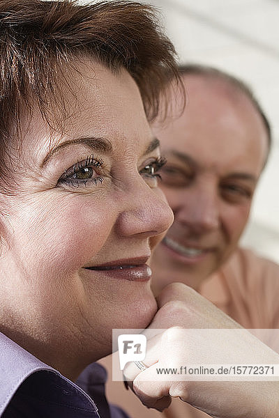 View of a mature couple smiling.