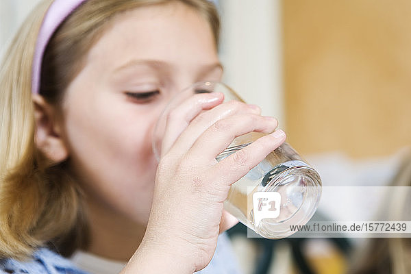 View of girl drinking water.