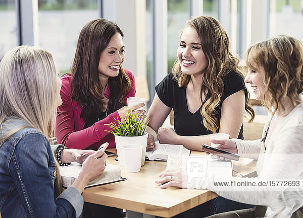 A group of women gathered together for a Bible study in a coffee shop at a church; Edmonton  Alberta  Canada