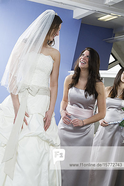 Cheerful woman conversing with bride.
