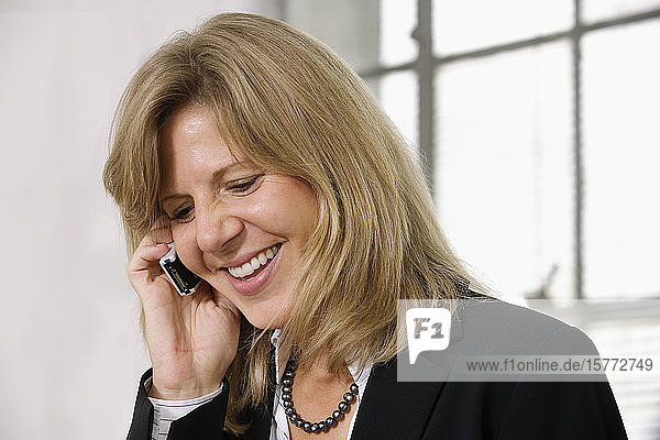 A business woman using cellphone.
