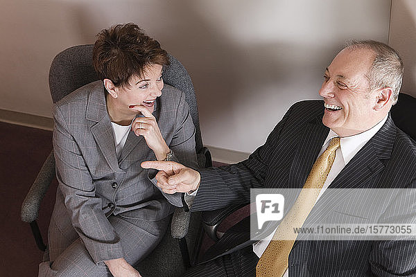 View of business people smiling in an office.