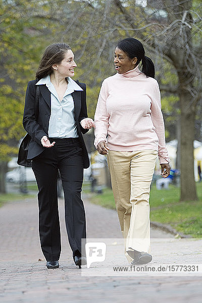 View of women walking together on a street.