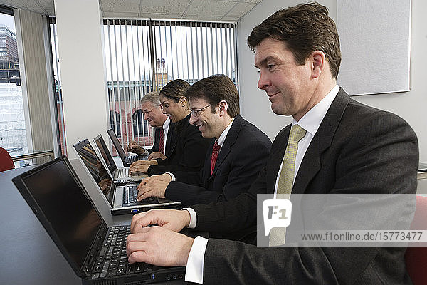 View of business people working in an office.