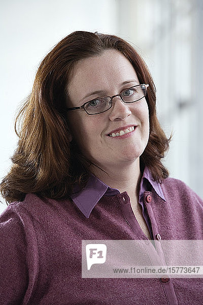 Portrait of a smiling woman.
