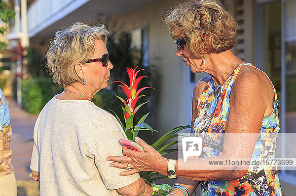 Two senior women greeting each other