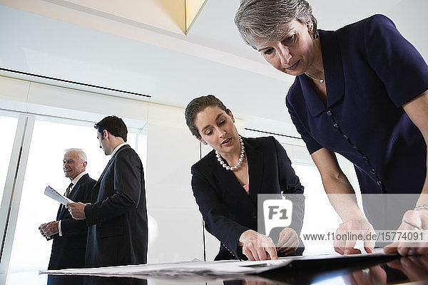 View of businesspeople planning in an office.