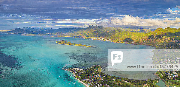 Aerial panoramic of turquoise lagoon surrounding Aux Benitiers and La Gaulette  Le Morne Brabant  Mauritius  Indian Ocean  Africa