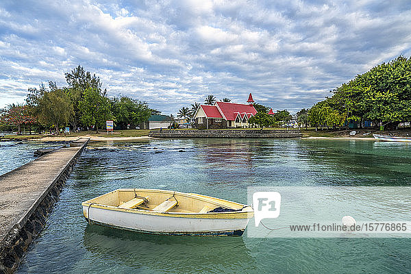Boat moored in the sea surrounding the Notre Dame Auxiliatrice Church  Cap Malheureux  Mauritius  Indian Ocean  Africa