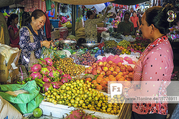 Woman shopping at a fruit stall in the central market at this old formerly French colonial river port city  Kampot  Cambodia  Indochina  Southeast Asia  Asia