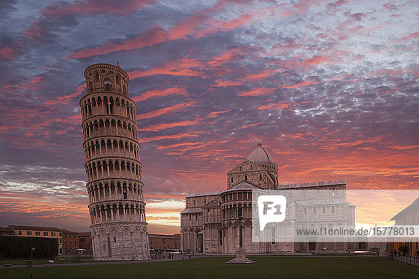 Leaning Tower of Pisa and Piazza dei Miracoli at sunset in Tuscany  Italy