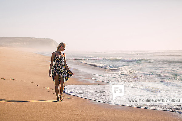 Woman wearing black dress on beach