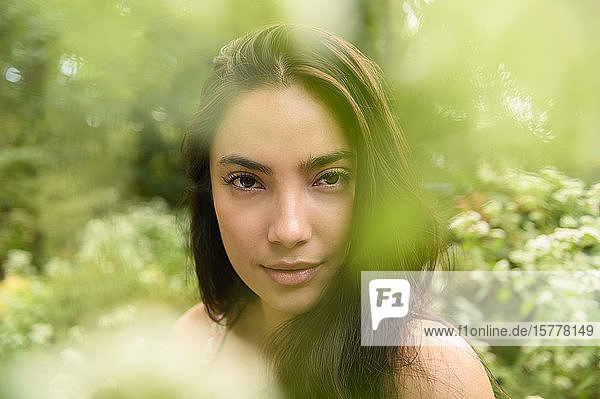 Portrait of woman by bush