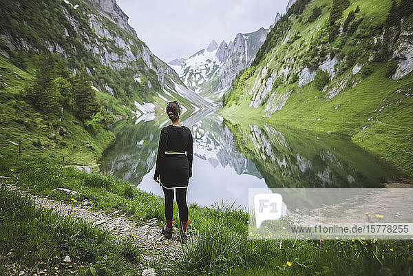 Woman by mountains and lake in Appenzell  Switzerland