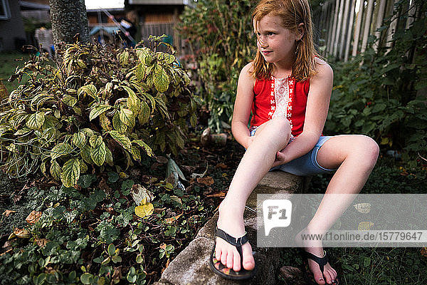 Girl relaxing in garden