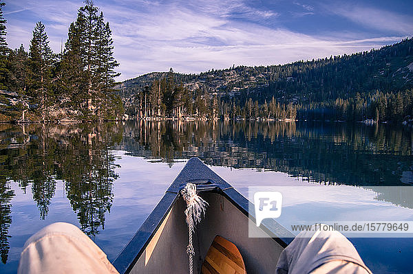 Man canoeing on Echo Lake  personal perspective  High Sierras  California  USA