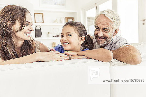 Happy family on couch in living room