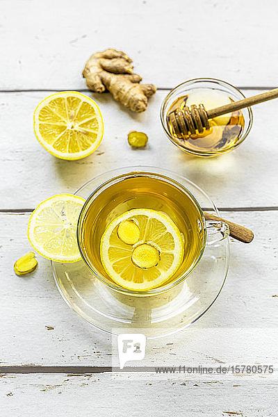 Studio shot of hot tea with ginger  lemon and honey