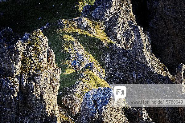 Man running on mountain ridge