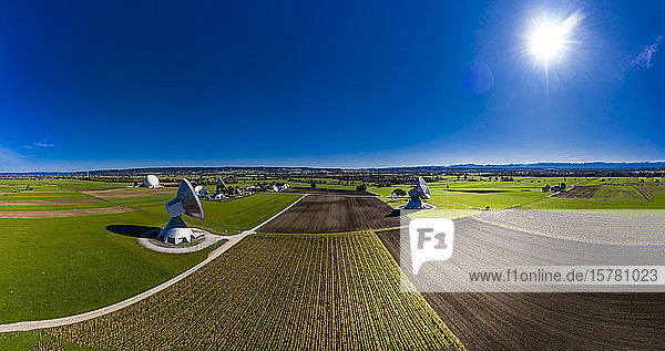 Germany  Bavaria  Aerial view of large parabolic antennas of the earth station Raisting and green fields