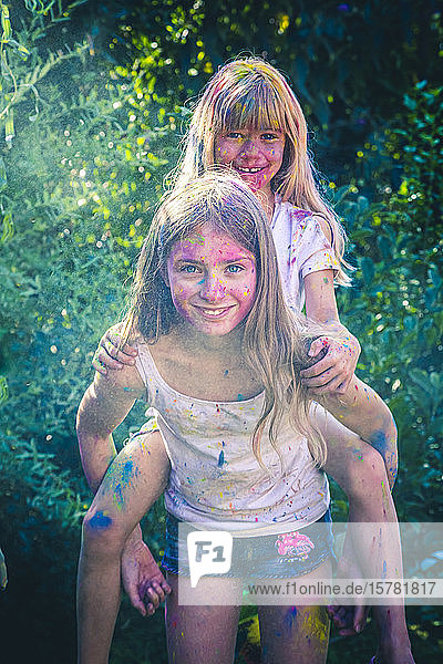 Portrait of two girls celebrating Festival of Colours