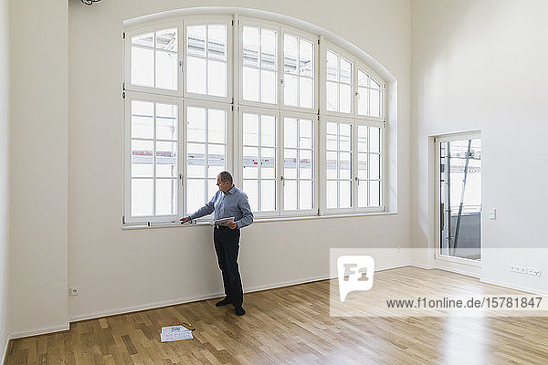 Man checking specifications of refurbished kuxury loft