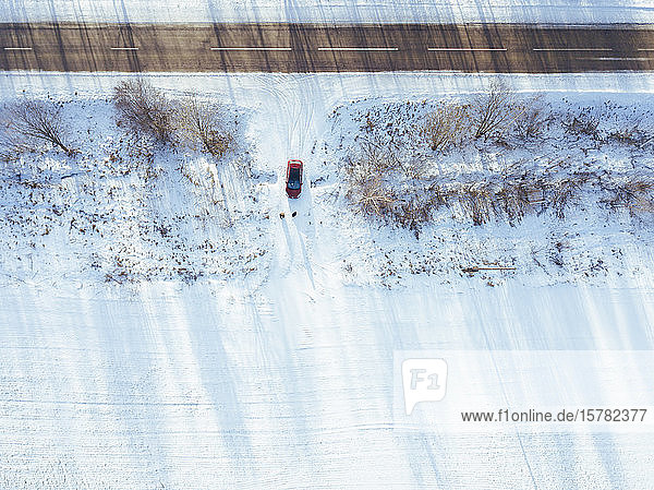 Russia  Moscow Oblast  Aerial view of car driving into snow-covered field