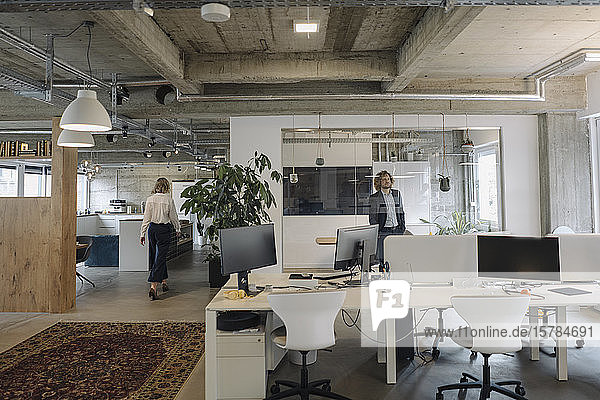 Businessman and businesswoman in modern office