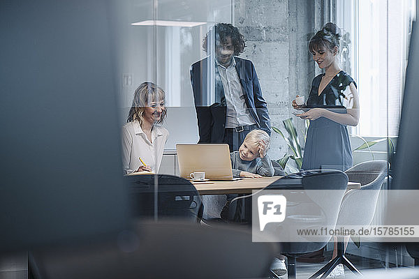 Business team with boy having a meeting in office