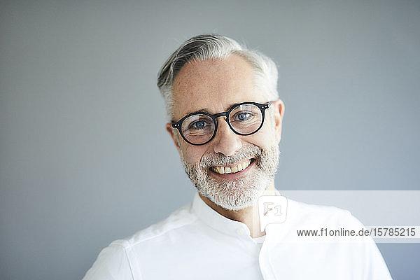 Portrait of happy mature man