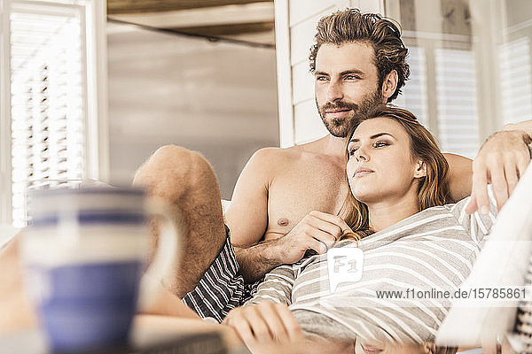 Young couple relaxing on a veranda