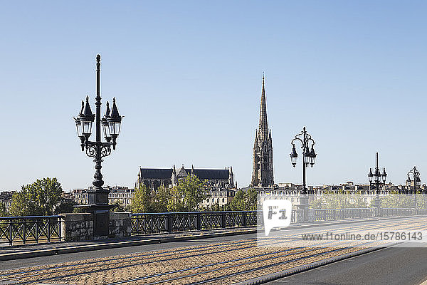 France  Gironde  Bordeaux  Clear sky overPontdePierre with Basilica of Saint Michael in background