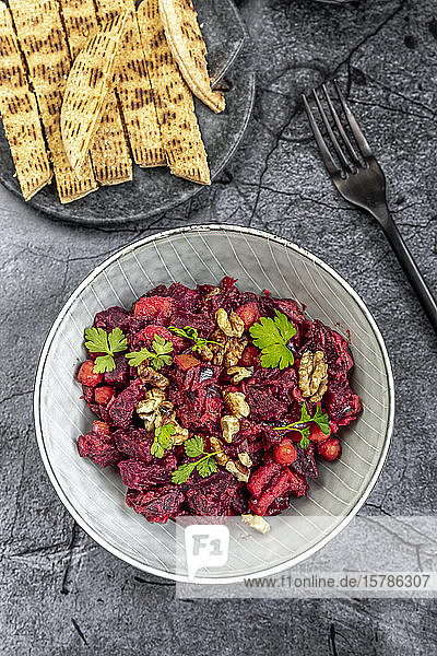 Pita bread and plate of beetroot salad with chick-peas  roasted walnuts and parsley
