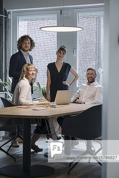 Portrait of confident business team having a meeting in office